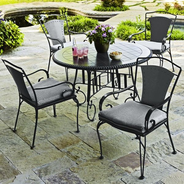 Wrought iron outdoor dining table and chairs for Wrought iron dining set outdoor